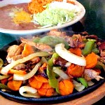 Steak, Chicken or Combo Fajitas $15.55